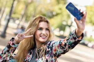 Beautiful young woman selfie in the park photo