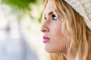 Close-up profile of blonde young woman with curly hair photo