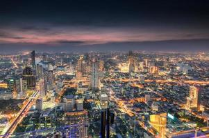 Cityscape of crowded building with light traffic at Bangkok city photo