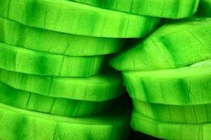 Green zucchini sliced into wheels photo