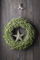 Christmas wreath hanging on the door photo
