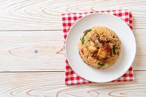 fried rice with Thai basil and crispy belly pork photo