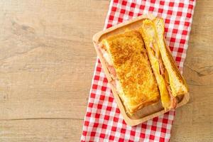 French toast ham bacon cheese sandwich photo