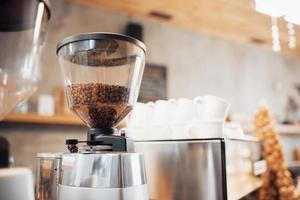Professional black electric grinder is on a wooden table photo