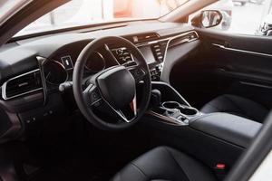 View of the interior of a modern automobile showing the dashboard photo