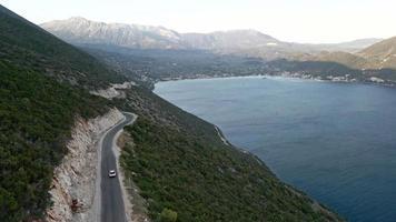 car travel concept aerial view of mountain road near sea at lefkada island video