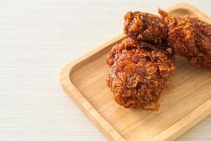 fried chicken with spicy Korean sauce photo