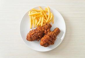 spicy Korean fried chicken with fries photo