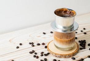 Hot milk coffee dripping in Vietnam style photo