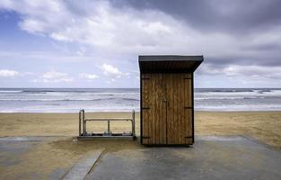 Wooden hut on the beach photo