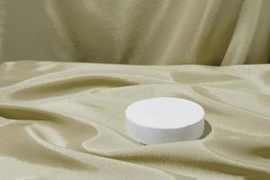Satin fabric folds and podium or pedestal for cosmetics or perfume photo