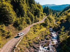 SUV car at off road. canyon in carpathian mountains photo