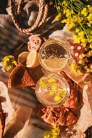 Picnic concept glasses of wine bun outdoors on blanket photo