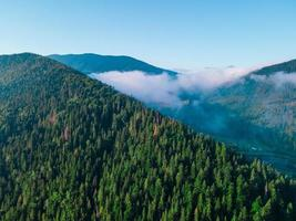 Aerial view of carpathian mountains range white clouds photo