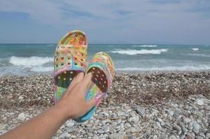 Coral slippers for swimming in the Aegean Sea photo