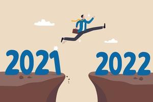 Year 2022 hope, new year resolution or success opportunity, change to new business bright future, overcome business difficulty concept, ambitious businessman jump over year gap from 2021 to 2022. vector