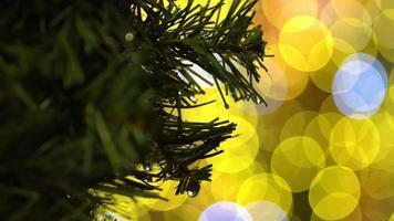 Christmas tree with gold bokeh light video