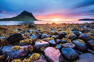 The picturesque sunset over landscapes and waterfalls. Kirkjufell mountain. Iceland photo