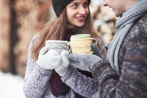 Cheerful young couple having fun in winter park photo