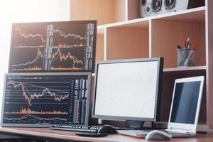 Stock exchange trader's workplace with computers photo