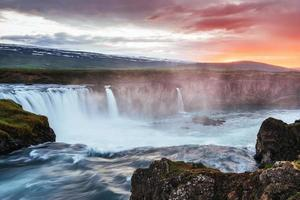 The picturesque sunset over landscapes and waterfalls. Kirkjufell mountain, Iceland photo