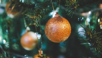Christmas toys hanging on the christmas tree photo