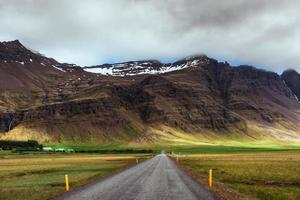 Road in mountains. Bridge over a channel connecting Jokulsarlon Lagoon and Atlantic Ocean in southern Iceland photo