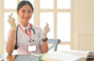 Medical personnel show encouragement and smile in the wake of a viral epidemic. photo