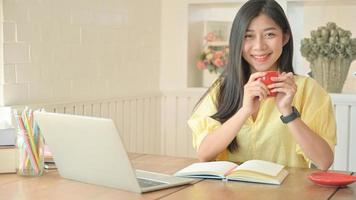 Asian woman with a laptop working at home. To prevent the spread of the coronavirus. photo