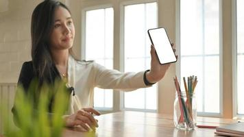 Girl holding a smartphone introducing the Corona virus health insurance package to customers. photo