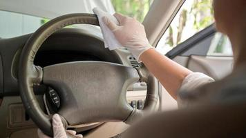 Cropped shot of Spray to clean and disinfect the steering wheel and inside the car. photo