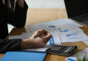 Accounting concept,Accounting staff is summarizing the company budget. photo