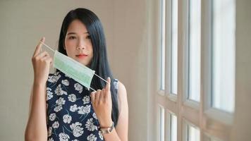 Portrait shot of Asian teenage girls wearing mask to protect against corona virus or covid-19. photo