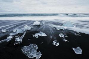 Iceland, Jokulsarlon lagoon, Beautiful cold landscape picture of icelandic glacier lagoon bay photo