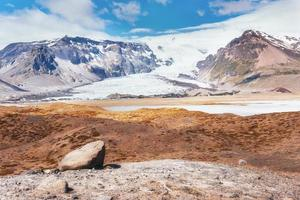 Valley National Park Landmannalaugar. On the gentle slopes of the mountains are snow fields and glaciers. Magnificent Iceland in the July photo