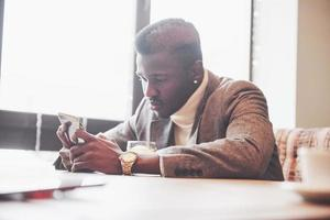 African american business man with laptop in a cafe photo
