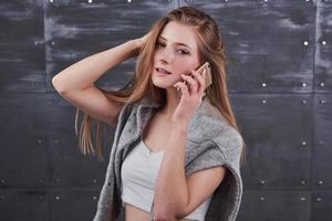 Image of young female using cellular phone photo