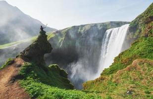 Great waterfall Skogafoss in south of Iceland near the town of Skogar. Dramatic and picturesque scene photo