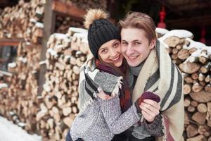 Young cheerful couple in a cabin in romantic scape in winter photo