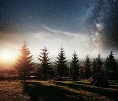 mountain range in the Carpathian Mountains in autumn night under the stars. Fantastic event. Ukraine, Europe photo