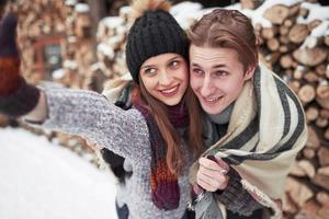 people, season, love and leisure concept - happy couple having fun over winter background photo