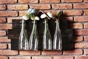 Interior decoration with bottles on brick wall with flowers. Great for wedding photo