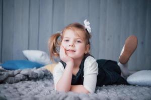 Cute little girl in a princess costume. Pretty child preparing for a costume party photo