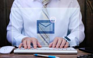 Email concept, Closeup businessman using computer with email icon photo