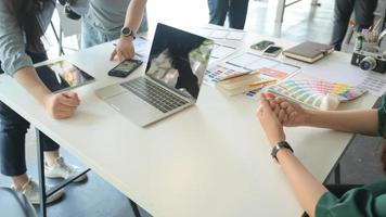 The UX team is designing an application for smartphones with a laptop in a modern office. photo