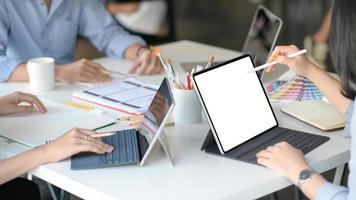 Graphic designer team uses laptops to design new projects for customers. photo