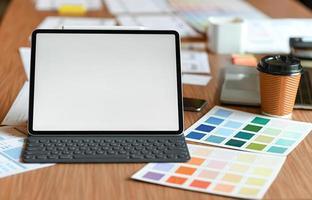 Designer desk space for designers. Color charts, model phones and tablet. photo