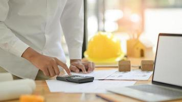 Architects are using calculators to design house plans for new projects. photo