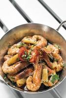 spicy sauteed asian stir fry king prawns with pineapple photo