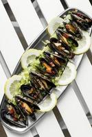 steamed mussels with pico de gallo tapas portion in barcelona photo